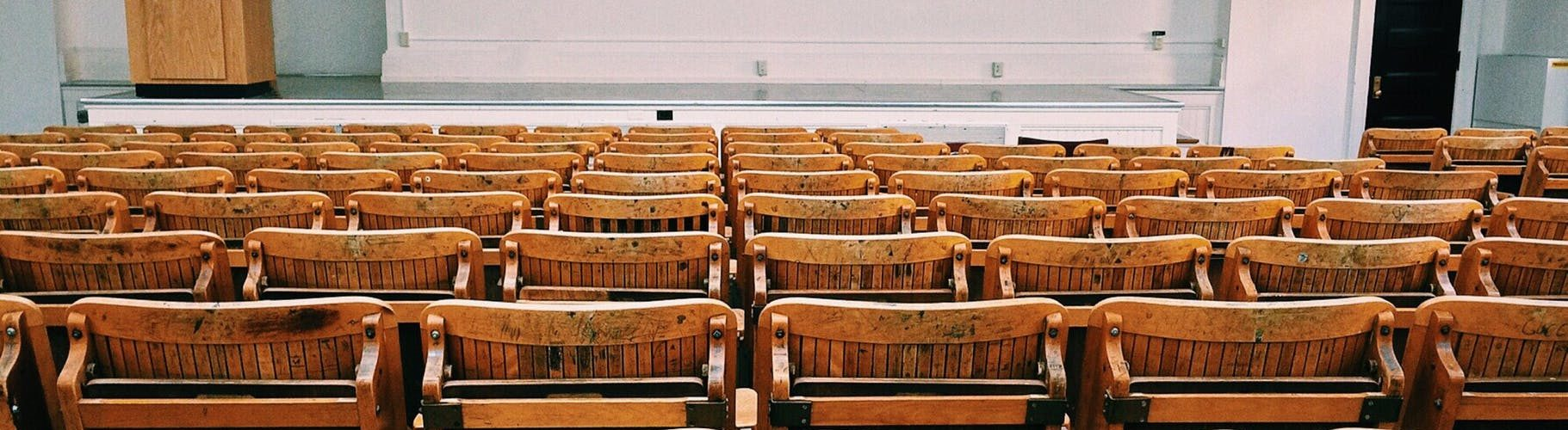 "Photo by Pixabay on ""https://www.pexels.com/photo/auditorium-benches-chairs-class-207691/"" Pexels.com"
